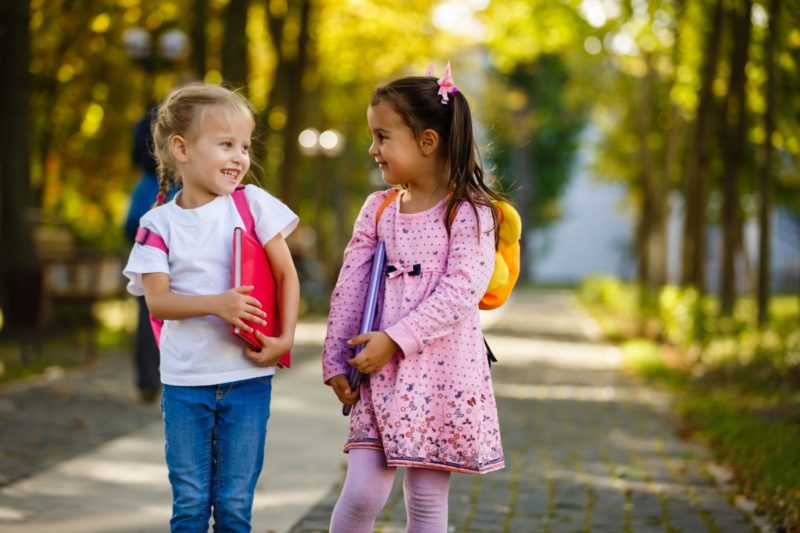 2 children with backpacks